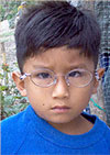 A small boy with eyeglasses