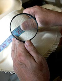 Grading hats with a magnifying glass
